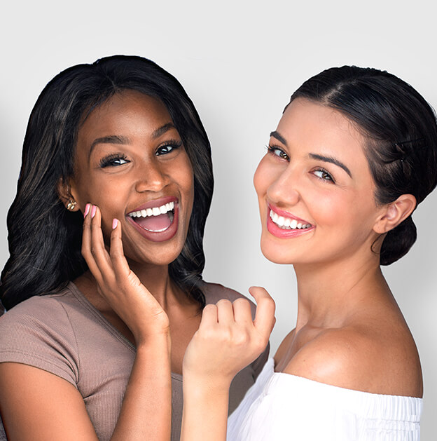 two women with beautiful smiles