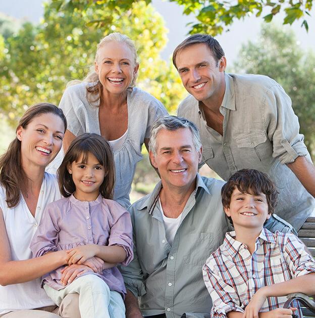 smiling multi-generational family enjoying the outdoors